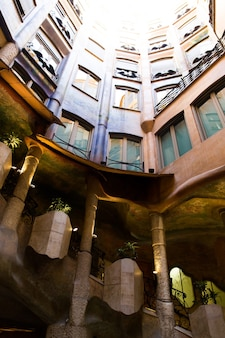 Barcelona, catalonia, spain, september 21, 2019. architectural details of the roof exterior in the modernist casa mila, also known as la pedrera, designed by antonio gaudi.
