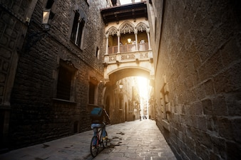 Barcelona people biking bicycle in Barri Gothic Quarter in Barcelona, Catalonia, Spain.