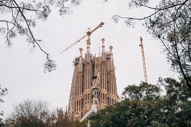 Barcelona spain  december construction cranes over sagrada familia barcelona spain