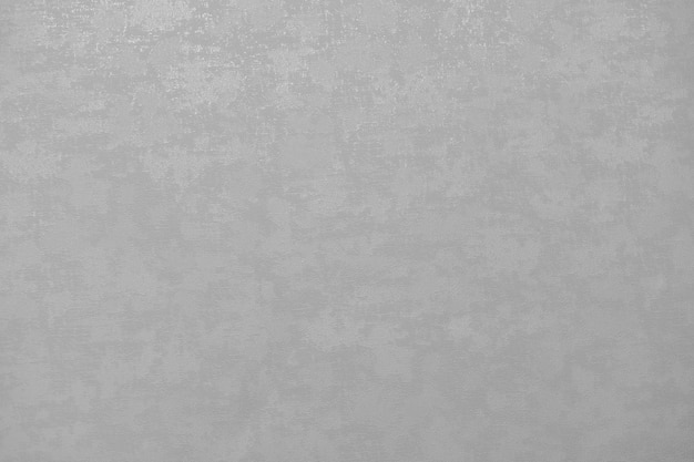 맨 손으로 석고 벽 배경. 회색 벽지