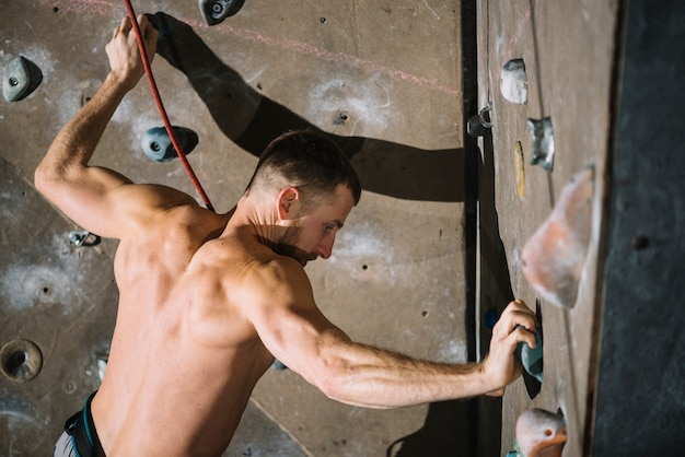 Barechested climber on wall