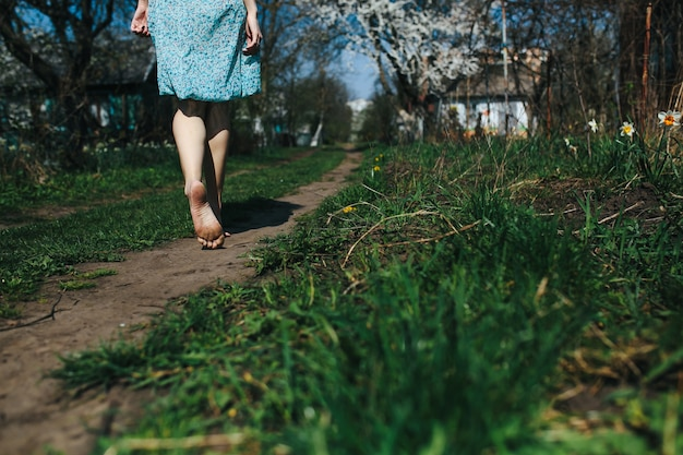Barefoot woman walking on the ground