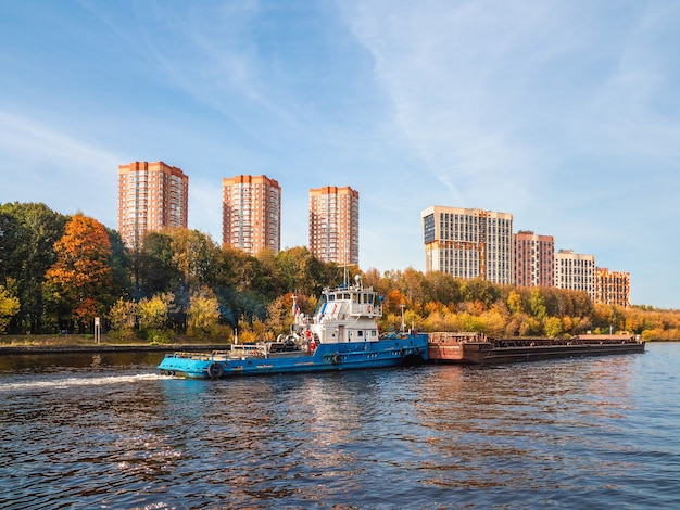 Barge on the river new residential neighborhood in the north of moscow russia