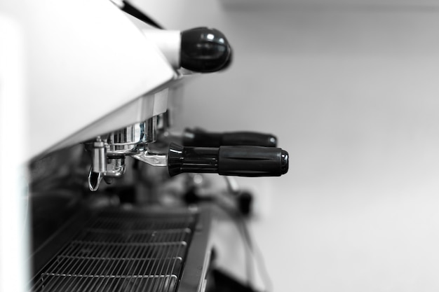 Barista in a coffee shop brews coffee in a coffee machine