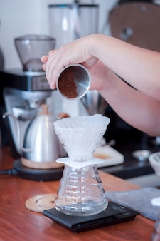 Barista hand pouring fresh roasted coffee