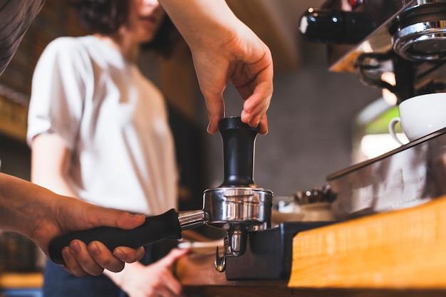 Barista hand preparing cappuccino in coffee shop