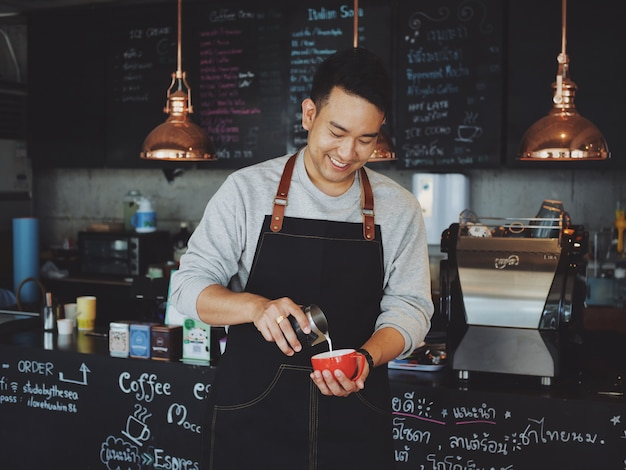 Barista make coffee in cafe