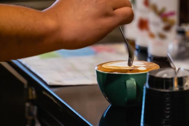 Barista make coffee latte art