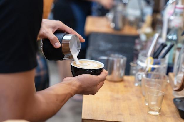 Barista make a hot coffee