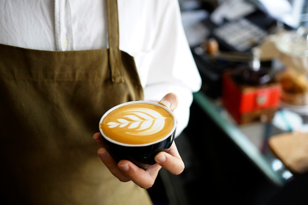 Barista making coffee latte art.