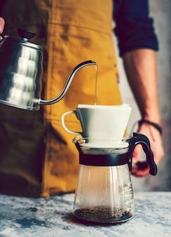 Barista making hot drip coffee