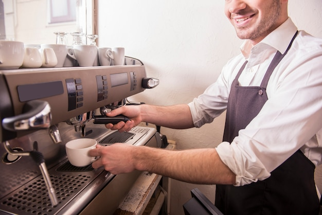 Barista prepares fresh coffee at the coffee shop.