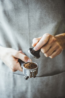 Barista ready for making classic espresso