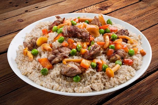 豚肉と森のキノコと大麦のお粥