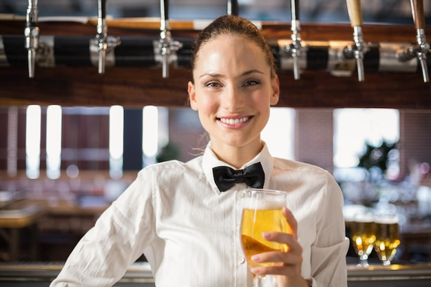 Barmaid holding a beer