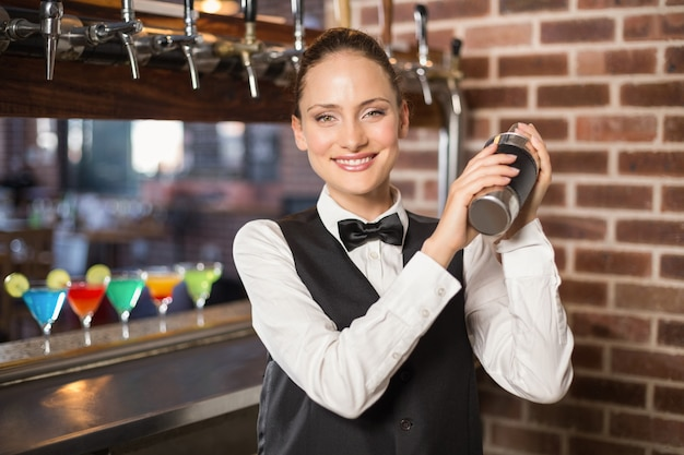 Barmaid shaking a cocktail