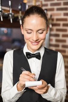 Barmaid taking orders