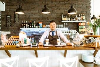 Barman behind bar