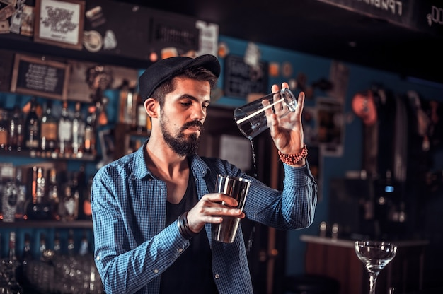 Barman concocts a cocktail at the porterhouse