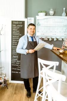 Barman holding menu