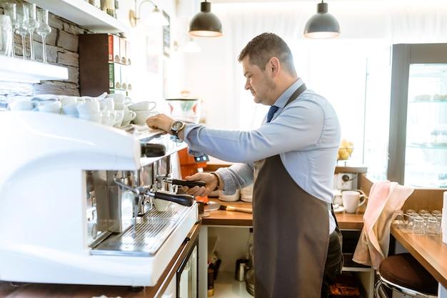 Barman making coffee