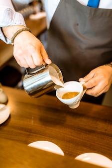 Barman making milk coffee