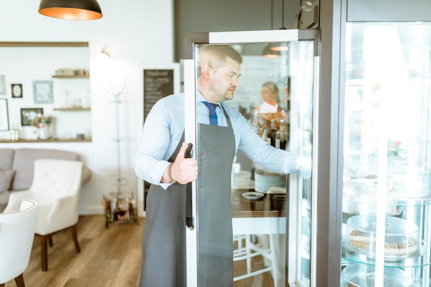 Barman opening fridge