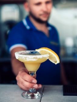 Barman serving beverage in pub