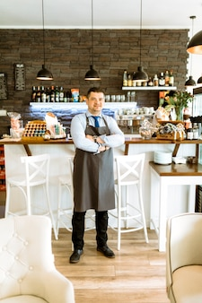 Barman with arms crossed