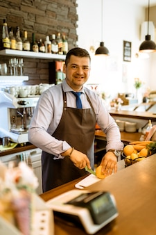 Barman with fruits