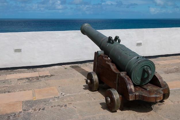 Barra lighthouse defense cannon in salvador bahia brazil.