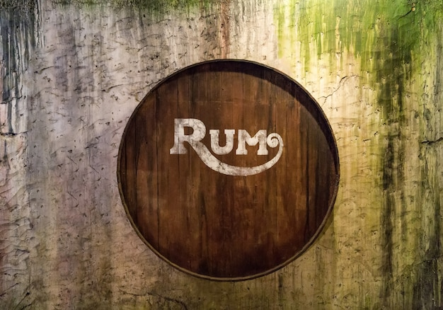 Barrels on the grunge wall, with rum written