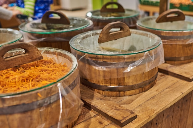 Barrels of sauerkraut and carrots at the store for any purpose