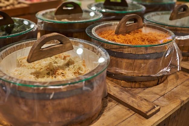 Barrels of sauerkraut and carrots at the store