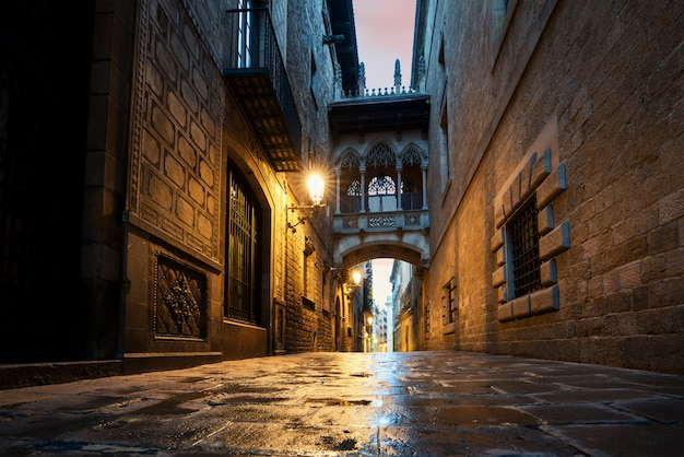 Barri gothic quarter and bridge of sighs at night in barcelona, catalonia, spain.