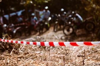 Barricade plastic rope with mountain bikes racing