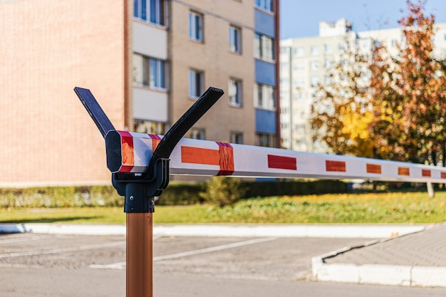 A barrier at the entrance to the courtyard of a residential area. private property protection. selective focus. blurred background.