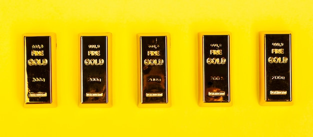 Bars of gold bullion on yellow