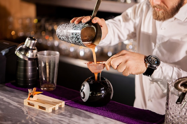 Bartender bartender is pouring a drink. alcoholic drink