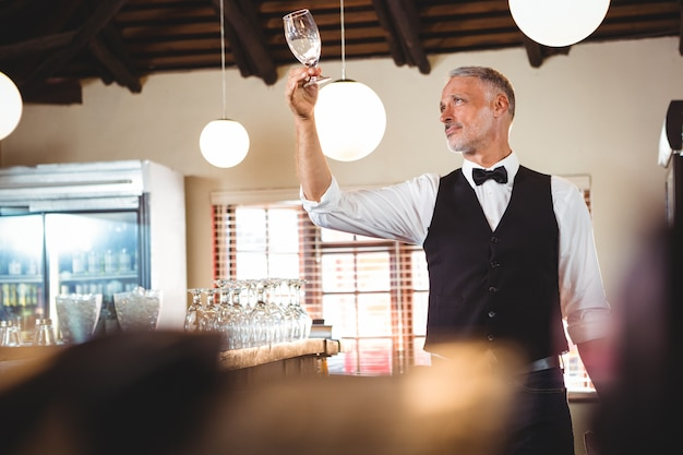 Bartender examining a clean wine glass