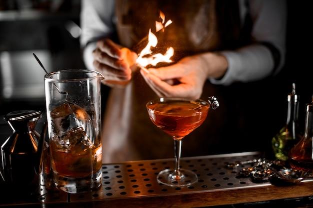 Bartender firing up a match