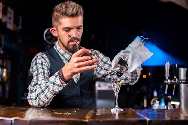Bartender makes a cocktail in the pothouse