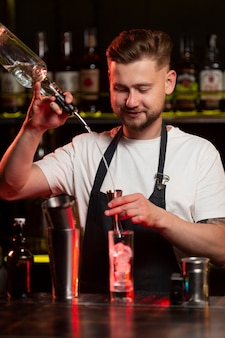 Bartender making a cocktail with a shaker