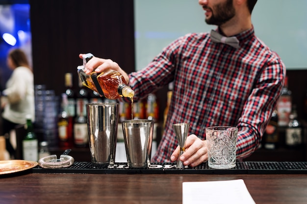 Bartender making cocktails in a club