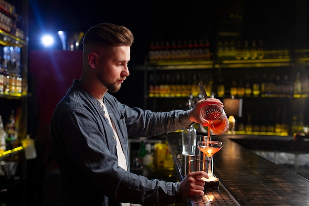 Bartender making a delicious refreshing cocktail