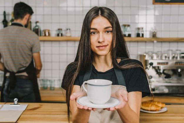 Bartender offering hot drink