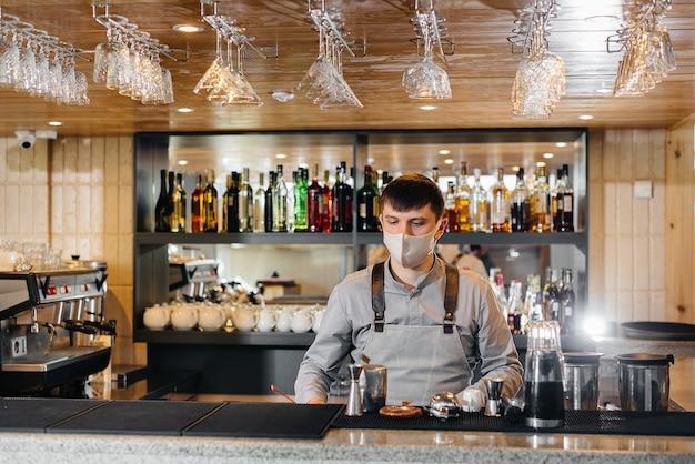 The bartender prepares cocktails in a modern restaurant.