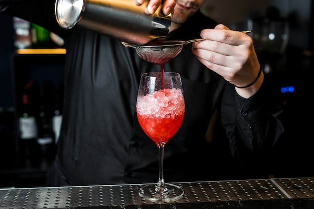 Bartender prepares margarita cocktail, close-up