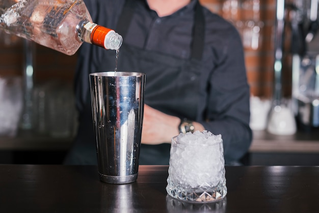 Bartender preparing a refreshing cocktail