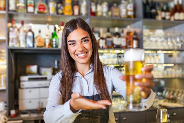 Bartender serving a draft beer at the bar counter